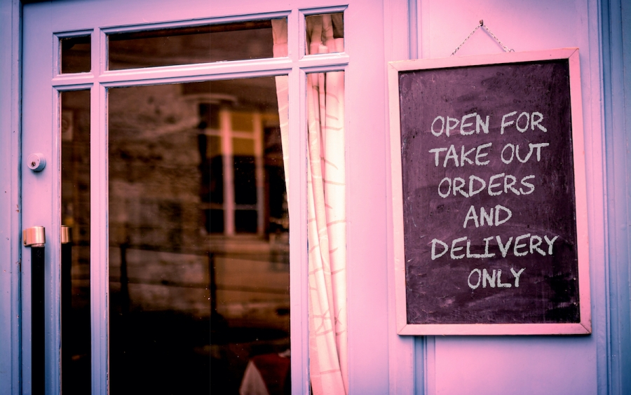 Restaurant sign only open for take out and delivery during coronavirus